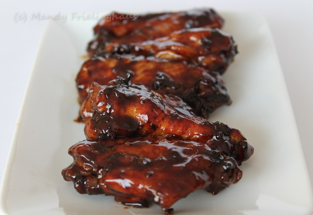 Rinse chicken wings and pat dry. Remove tip and discard; separate each wing at the joint into 2 pieces. Place wings in a shallow dish and pour over the soy sauce, ginger, cilantro, garlic, and.